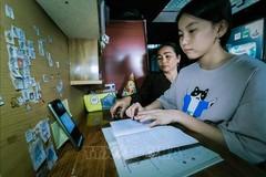Học sinh Cần Thơ học trực tuyến. Ảnh: Thanh Liêm/TTXVN
