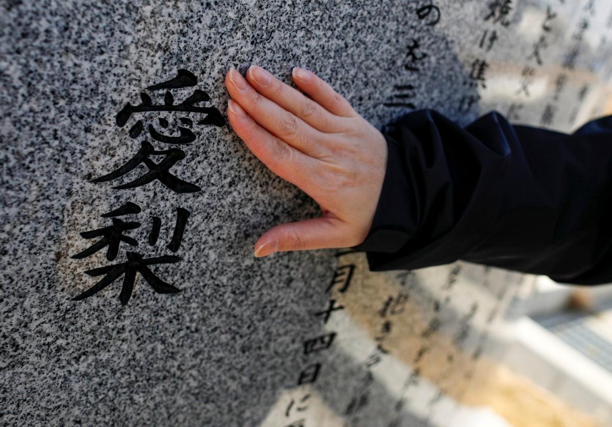 Nỗi buồn khôn nguôi của người sống sót sau thảm họa sóng thần ở Nhật Bản ảnh 5
