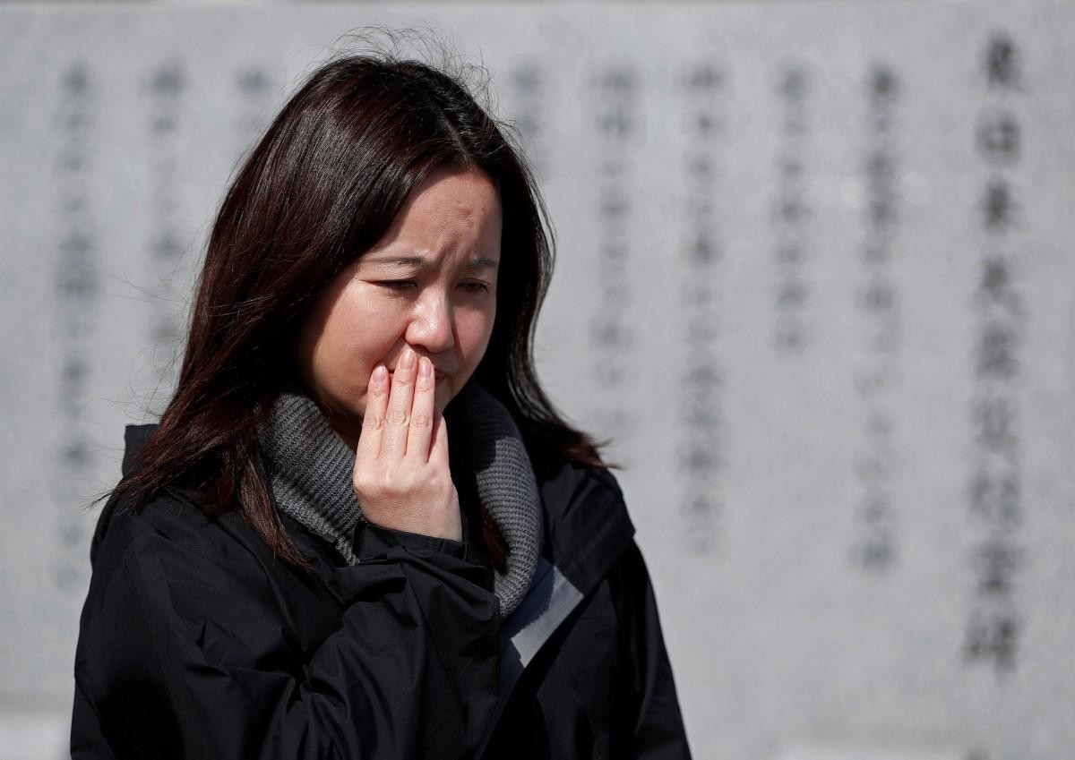 Nỗi buồn khôn nguôi của người sống sót sau thảm họa sóng thần ở Nhật Bản ảnh 4