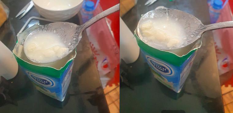 Theo phản ánh của chị Thảo, phần sữa bên trong hộp sữa tươi Dutch Lady 180ml đã bị vón cục gần hết và bốc ra mùi hôi nồng rất khó chịu. (Ảnh do NVCC)