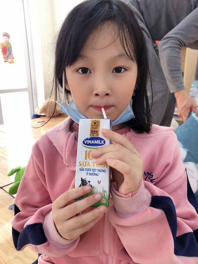 Vinamilk hỗ trợ sữa cho trẻ em phải đón Tết ở nơi cách ly ảnh 1