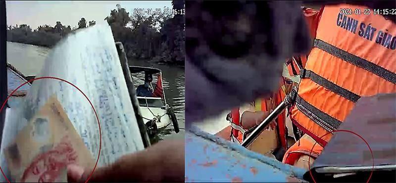Tiền kẹp vào sổ trước khi trình cho thanh tra giao thông và cảnh sát đường thủy trên sông Đồng Nai. Ảnh: T.SANG - V.HỘI