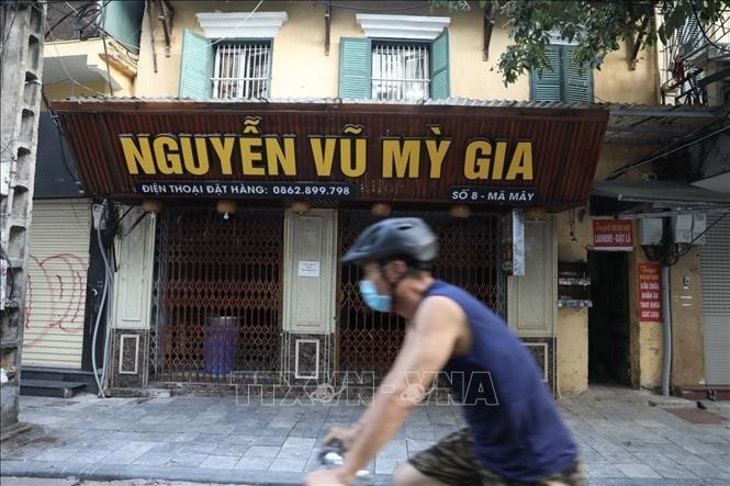 Người dân Hà Nội nghiêm túc chấp hành quy định về phòng, chống dịch COVID-19. Ảnh minh họa: Minh Quyết/TTXVN