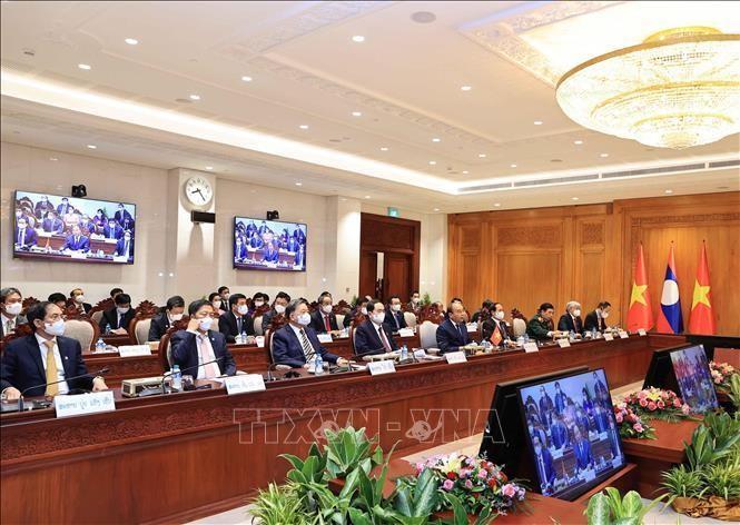 Chủ tịch nước Nguyễn Xuân Phúc và các thành viên Đoàn đại biểu Việt Nam tham dự buổi hội kiến. (Ảnh: TTXVN)