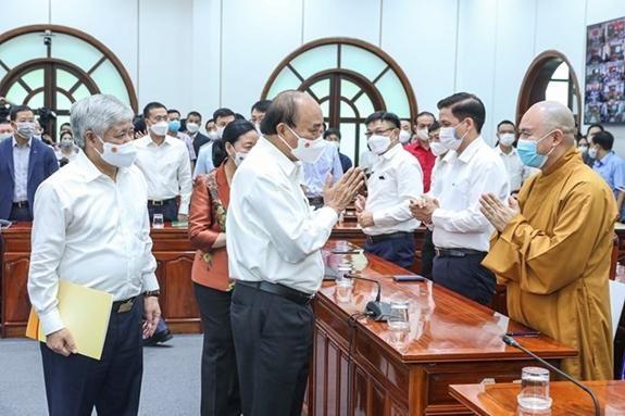 Chủ tịch nước Nguyễn Xuân Phúc và các đại biểu dự lễ phát động. Ảnh: QĐND