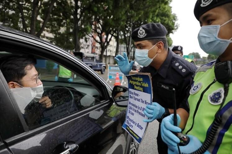 Malaysia gia hạn lệnh hạn chế di chuyển tới tháng 4