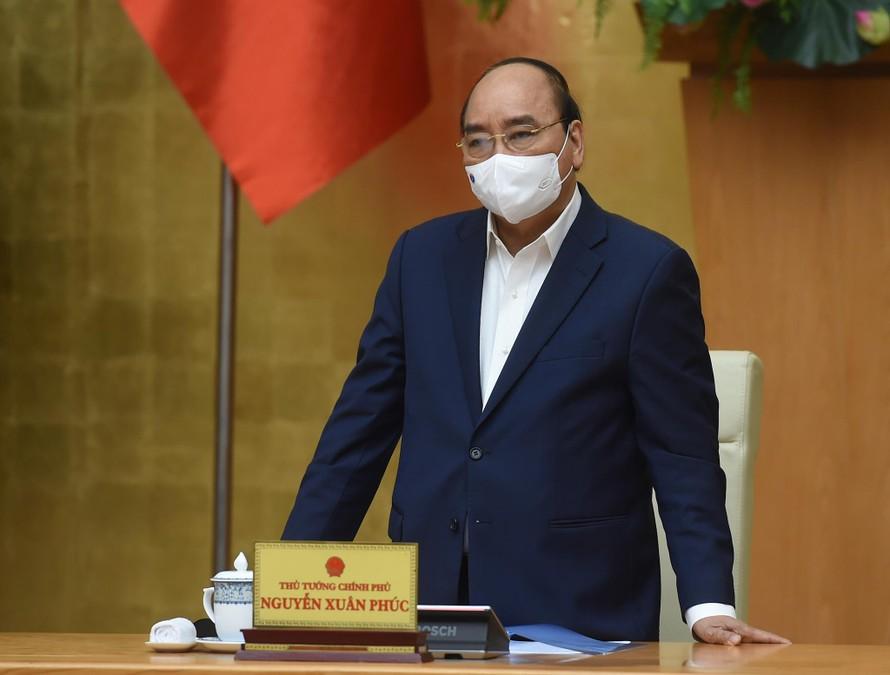 Thủ tướng Nguyễn Xuân Phúc phát biểu kết luận cuộc họp Thường trực Chính phủ về công tác phòng chống dịch COVID-19. Ảnh: VGP/Quang Hiếu