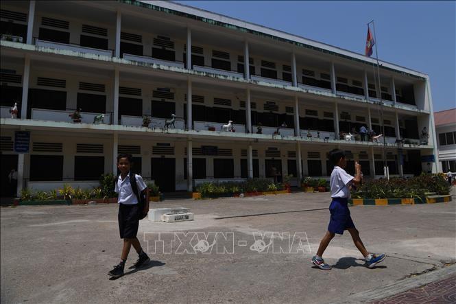 Học sinh tại một trường tiểu học ở Phnom Penh, Campuchia, ngày 14/3/2020. Ảnh: AFP/TTXVN