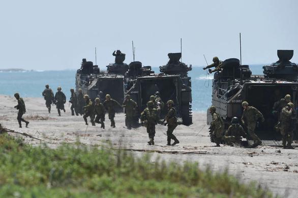 Binh sĩ thuộc Lực lượng phòng vệ mặt đất Nhật Bản trong một cuộc tập trận đổ bộ năm 2018 - Ảnh: AFP