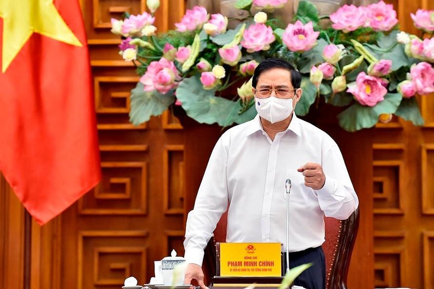 Thủ tướng Phạm Minh Chính phát biểu kết luận cuộc làm việc với Bộ Xây dựng - Ảnh: VGP/Nhật Bắc