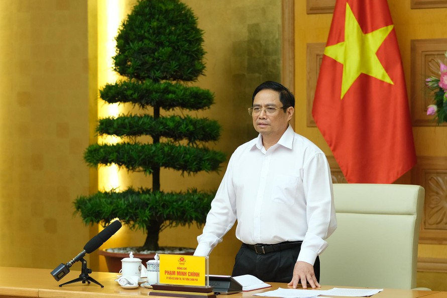 Thủ tướng Phạm Minh Chính phát biểu tại cuộc làm việc với các nhà khoa học, các đơn vị, doanh nghiệp tham gia nghiên cứu, sản xuất vaccine phòng chống COVID-19 tại Việt Nam. Ảnh: VGP/Quang Hiếu