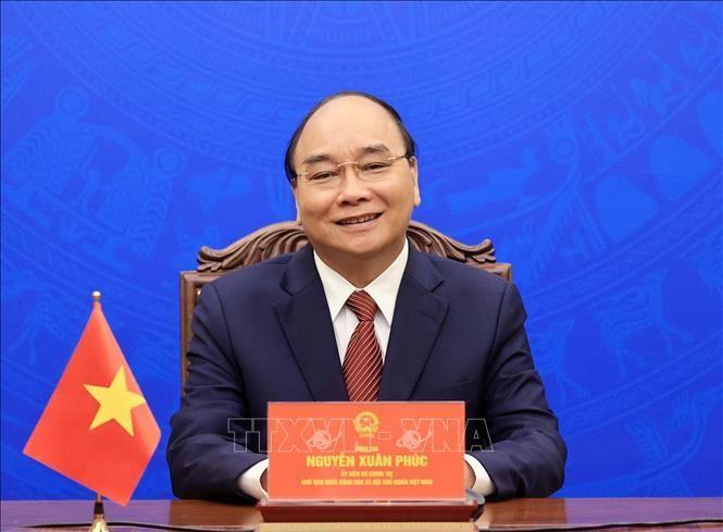 Chủ tịch nước Nguyễn Xuân Phúc tại buổi làm việc trực tuyến với ông Choi Young Joo. Ảnh: TTXVN