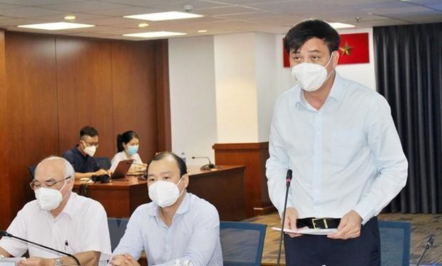 Ông Lê Hòa Bình, Phó Chủ tịch Ủy ban Nhân dân Thành phố Hồ Chí Minh, phát biểu tại họp báo. (Ảnh: Xuân Anh/TTXVN)