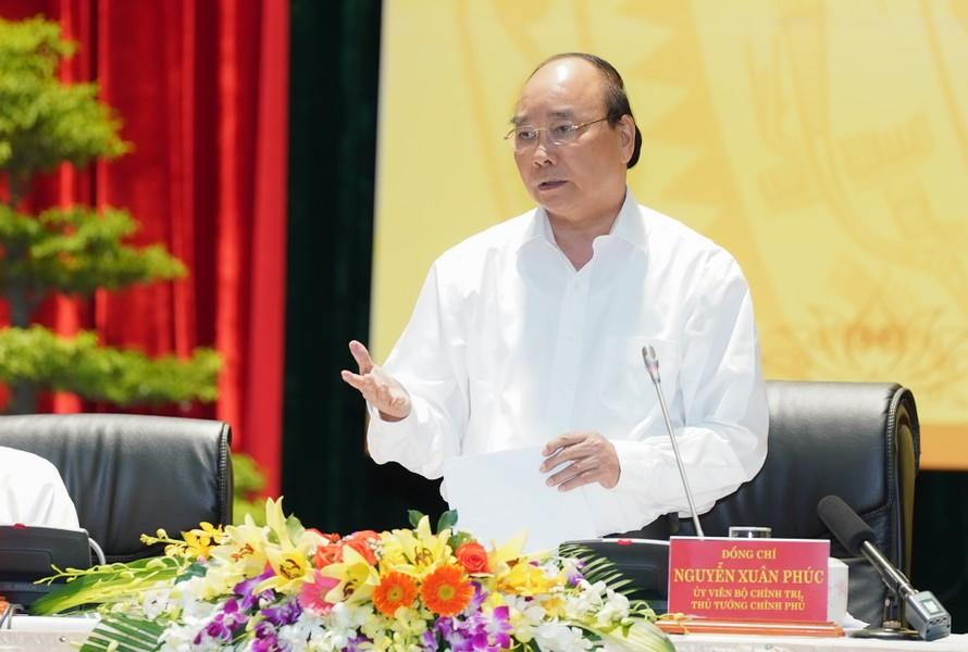 Thủ tướng Nguyễn Xuân Phúc phát biểu kết luận Hội nghị. - Ảnh: VGP/Quang Hiếu