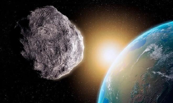 Mô phỏng thiên thạch bay gần Trái Đất. - Ảnh: Daily Star.