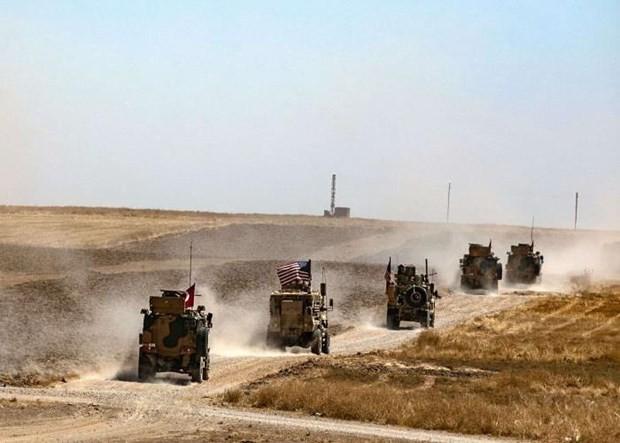 Quân đội Mỹ và Thổ Nhĩ Kỳ tuần tra chung tại Syria. (Nguồn: ahvalnews.com)