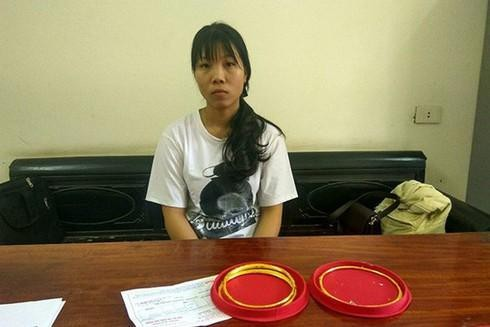 Lưu Thị Kim Anh tại cơ quan công an - Ảnh: Công an cung cấp