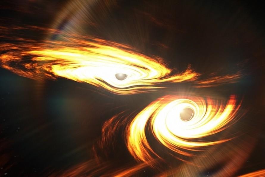 Hình ảnh mô phỏng quá trình hợp nhất giữa hai hố đen gần 7 tỷ năm trước để tạo ra GW190521. Ảnh: Mark Myers.