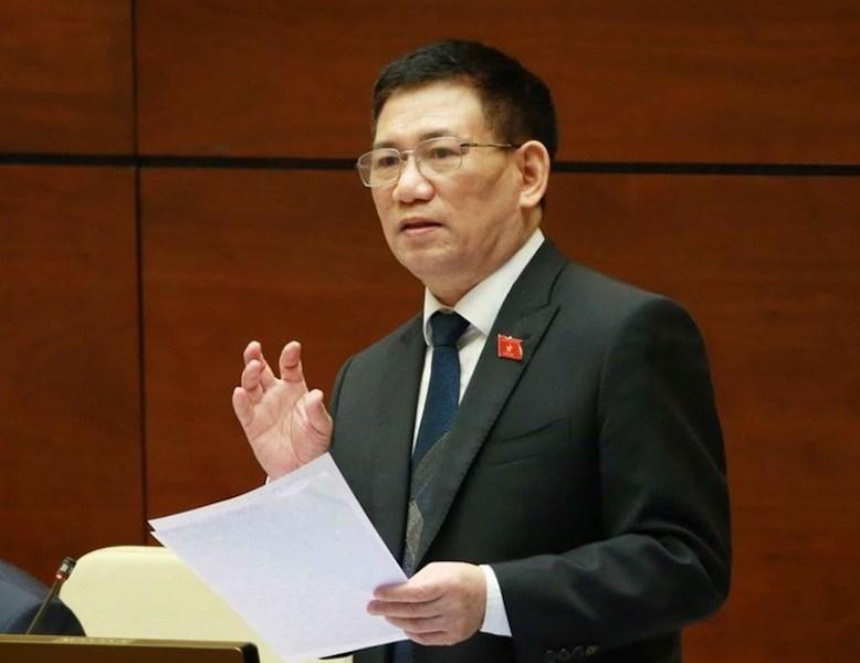 Bộ trưởng Bộ Tài chính trình bày báo cáo trước Quốc hội