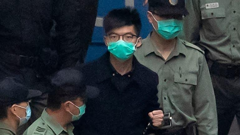 Joshua Wong đang thi hành án tù 13,5 tháng vì vai trò trong các cuộc biểu tình trên đường phố vào năm 2019, ảnh chụp tháng 3/2021 (Ảnh: AP)