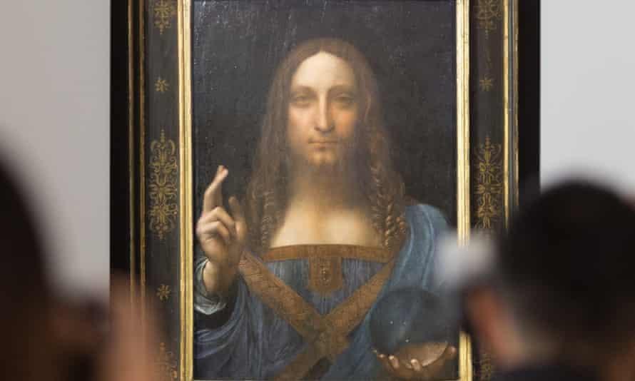 """""""Salvator Mundi"""" đã được bán đấu giá 450 triệu đô la (326 triệu bảng Anh) vào năm 2017, từng bị nhiều người tố cáo là đồ giả, và cũng có thời gian biến mất khỏi tầm mắt công chúng. Ảnh: Jérôme Favre / EPA"""