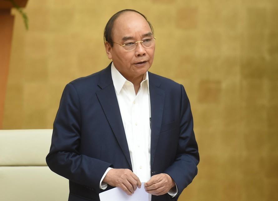 Thủ tướng Nguyễn Xuân Phúc phát biểu tại cuộc họp trực tuyến giữa Thường trực Chính phủ với Ban Chỉ đạo quốc gia phòng, chống dịch COVID-19 và 63 tỉnh, thành phố. Ảnh: VGP/Quang Hiếu