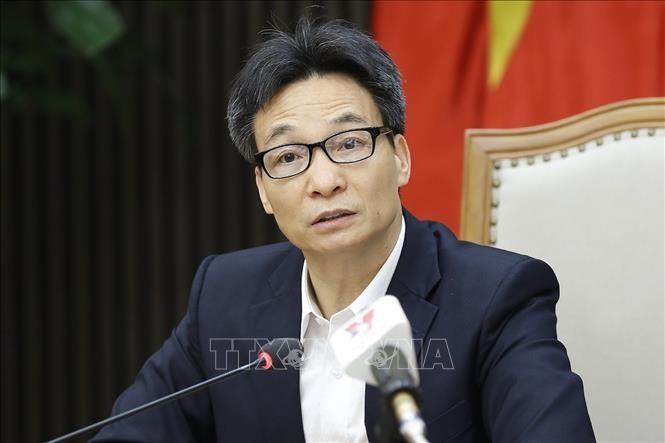 Phó Thủ tướng Vũ Đức Đam, Trưởng Ban Chỉ đạo Quốc gia phòng, chống dịch bệnh COVID-19 chủ trì cuộc họp. Ảnh: Dương Giang/TTXVN