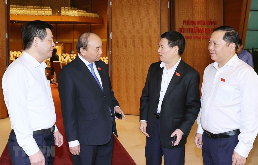 Thủ tướng Nguyễn Xuân Phúc với các đại biểu Quốc hội. (Ảnh: Thống Nhất/TTXVN)