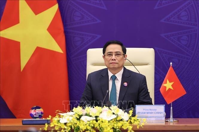 Thủ tướng Chính phủ Phạm Minh Chính phát biểu tại Hội nghị Thượng đỉnh Đối tác về Tăng trưởng xanh và Mục tiêu toàn cầu 2030. Ảnh: Dương Giang-TTXVN