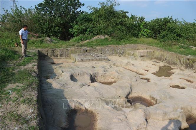 Hố thám sát của các nhà khảo cổ khai quật nghiên cứu khảo cổ học cụm di chỉ Vườn Chuối năm 2019. Ảnh tư liệu: Mạnh Khánh/TTXVN