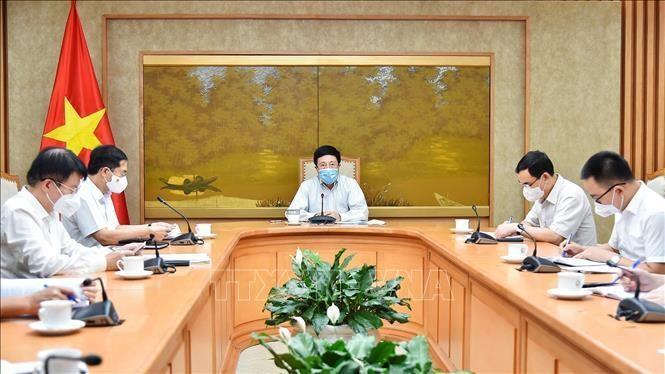 Phó Thủ tướng Phạm Bình Minh đã chủ trì cuộc họp với Tổ công tác của Chính phủ về ngoại giao vaccine. Ảnh: TTXVN phát