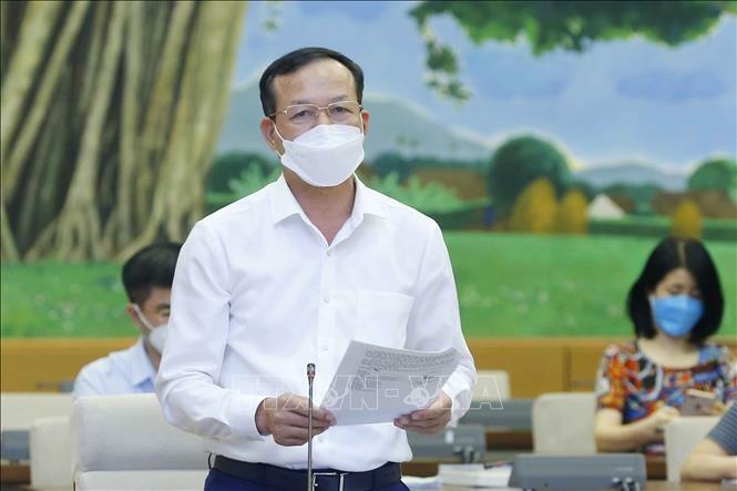 Phó Chánh án Tòa án nhân dân tối cao Nguyễn Trí Tuệ trình bày văn bản. Ảnh: Doãn Tấn/TTXVN